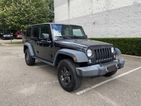 2016 Jeep Wrangler Unlimited for sale at Select Auto in Smithtown NY