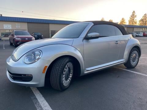 2015 Volkswagen Beetle Convertible for sale at Exelon Auto Sales in Auburn WA