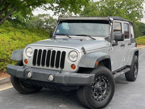 2011 Jeep Wrangler Unlimited for sale at William D Auto Sales in Norcross GA