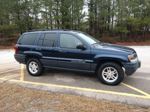 2004 Jeep Grand Cherokee for sale at WIGGLES AUTO SALES INC in Mableton GA