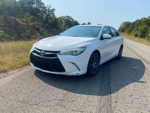 2015 Toyota Camry for sale at TINKER MOTOR COMPANY in Indianola OK