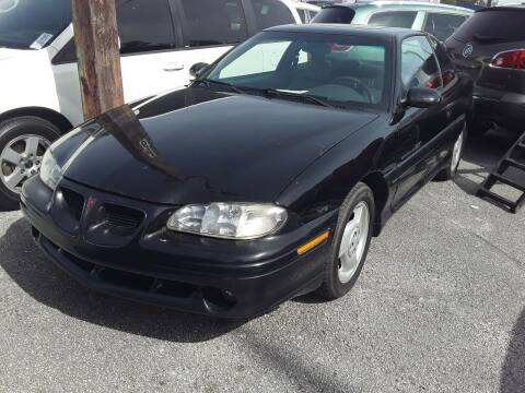 1997 Pontiac Grand Am for sale at Louie's Auto Sales in Leesburg FL