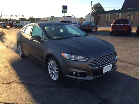 2014 Ford Fusion for sale at Carney Auto Sales in Austin MN