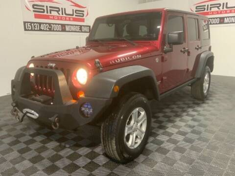 2011 Jeep Wrangler Unlimited for sale at SIRIUS MOTORS INC in Monroe OH