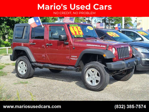 2011 Jeep Wrangler Unlimited for sale at Mario's Used Cars in Houston TX