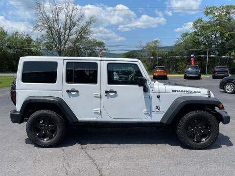 2017 Jeep Wrangler Unlimited for sale at MAGNUM MOTORS in Reedsville PA
