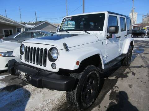 2015 Jeep Wrangler Unlimited for sale at Dam Auto Sales in Sioux City IA
