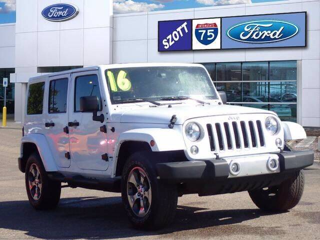 2016 Jeep Wrangler Unlimited for sale at Szott Ford in Holly MI