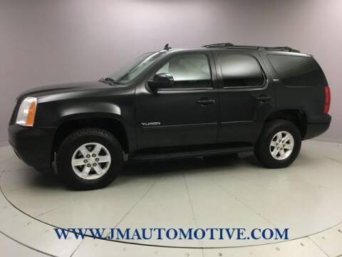 2012 GMC Yukon for sale at J & M Automotive in Naugatuck CT