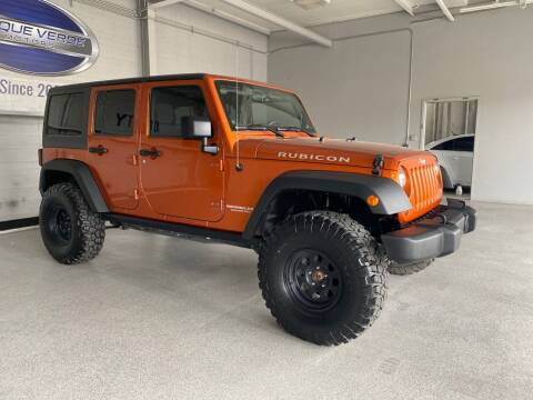 2011 Jeep Wrangler Unlimited for sale at TANQUE VERDE MOTORS in Tucson AZ