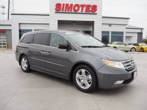 2013 Honda Odyssey for sale at SIMOTES MOTORS in Minooka IL