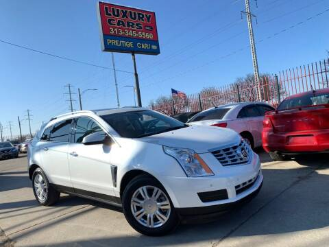 2014 Cadillac SRX for sale at Dymix Used Autos & Luxury Cars Inc in Detroit MI