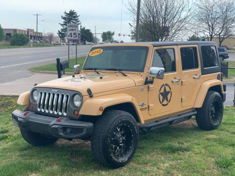 2013 Jeep Wrangler Unlimited for sale at Bagwell Motors in Lowell AR