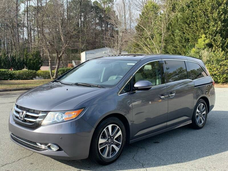 2014 Honda Odyssey for sale at Triangle Motors Inc in Raleigh NC
