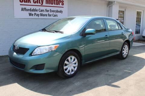2010 Toyota Corolla for sale at Oak City Motors in Garner NC
