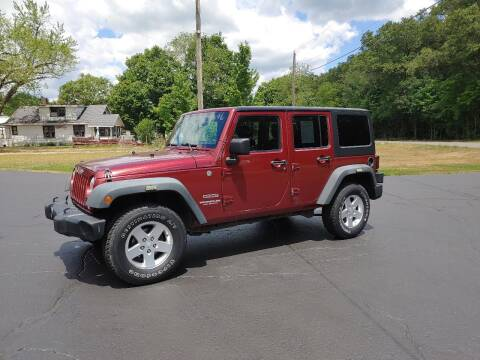 2012 Jeep Wrangler Unlimited for sale at Depue Auto Sales Inc in Paw Paw MI