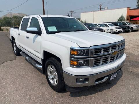 2015 Chevrolet Silverado 1500 for sale at BERKENKOTTER MOTORS in Brighton CO