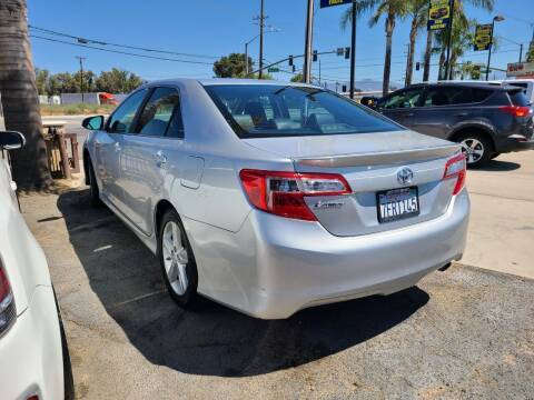 2014 Toyota Camry for sale at E and M Auto Sales in Bloomington CA