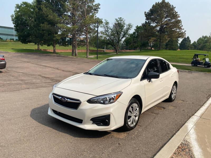 2017 Subaru Impreza for sale at QUEST MOTORS in Englewood CO