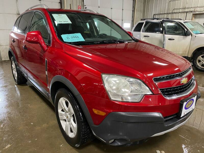 2013 Chevrolet Captiva Sport for sale at BERG AUTO MALL & TRUCKING INC in Beresford SD