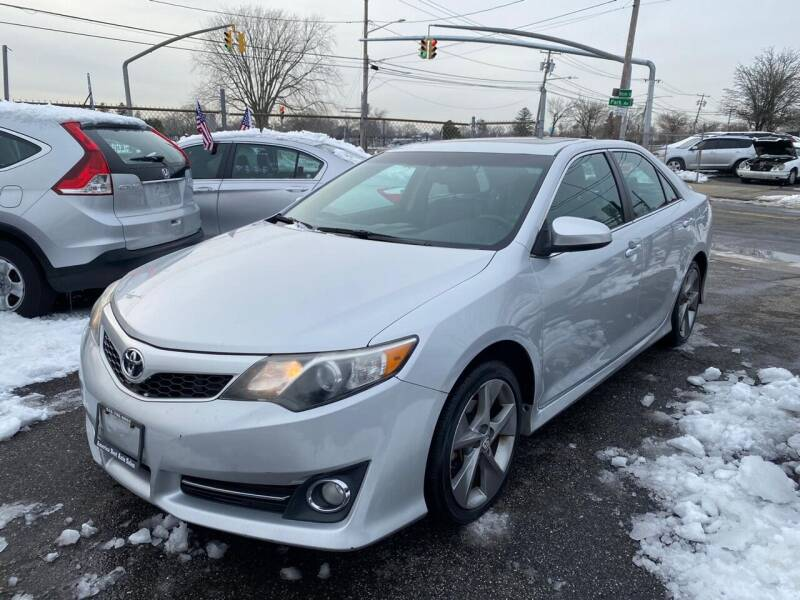 2014 Toyota Camry for sale at American Best Auto Sales in Uniondale NY