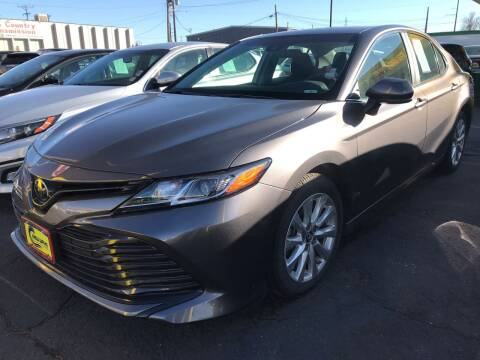 2018 Toyota Camry for sale at New Wave Auto Brokers & Sales in Denver CO
