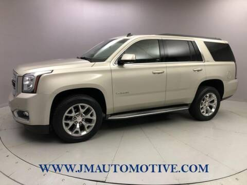 2015 GMC Yukon for sale at J & M Automotive in Naugatuck CT
