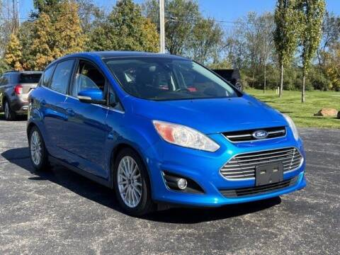 2015 Ford C-MAX Hybrid for sale at Szott Ford in Holly MI