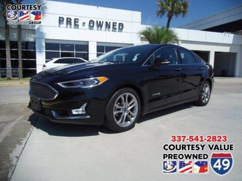 2019 Ford Fusion Hybrid for sale at Courtesy Value Pre-Owned I-49 in Lafayette LA