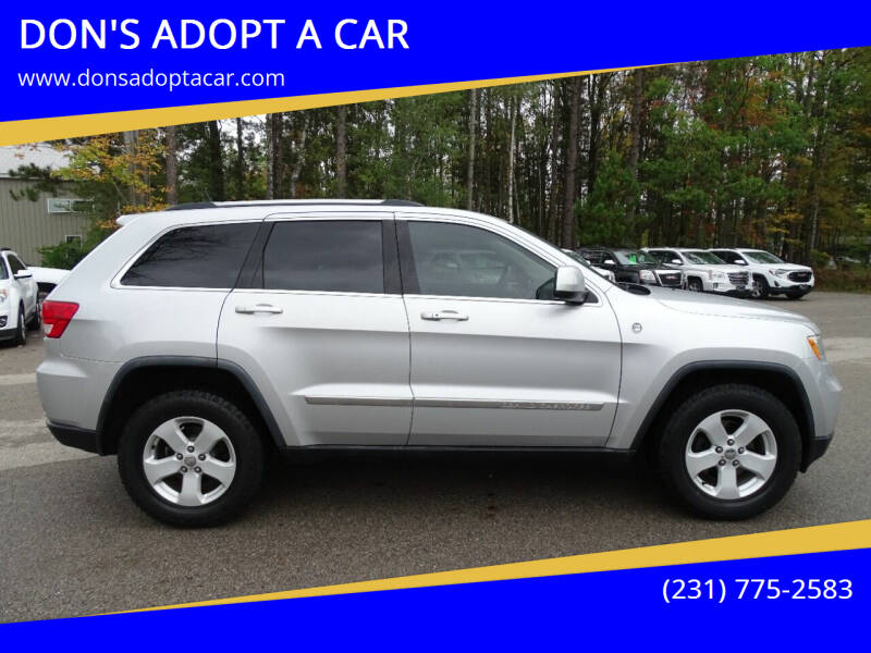 2011 Jeep Grand Cherokee for sale at DON'S ADOPT A CAR in Cadillac MI