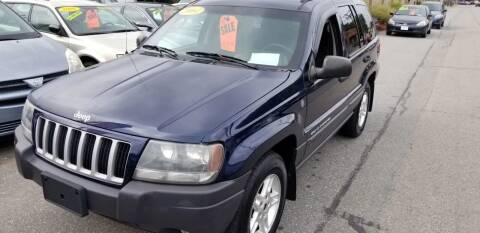 2004 Jeep Grand Cherokee for sale at Howe's Auto Sales in Lowell MA