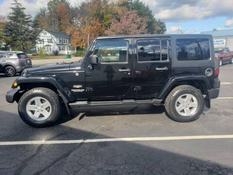 2013 Jeep Wrangler Unlimited for sale at Healey Auto in Rochester NH