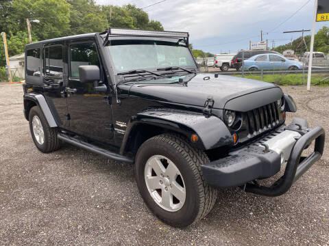 2011 Jeep Wrangler Unlimited for sale at MISSION AUTOMOTIVE ENTERPRISES in Plant City FL