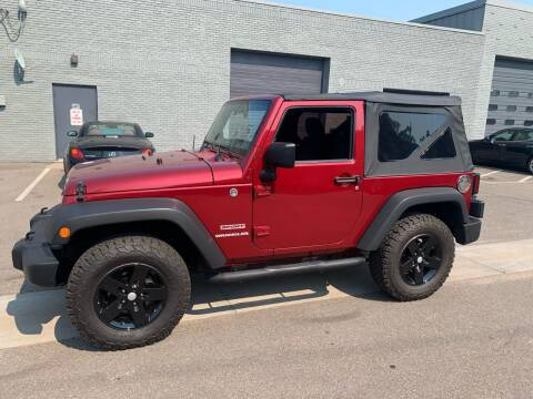 2012 Jeep Wrangler for sale at The Car Buying Center in Saint Louis Park MN