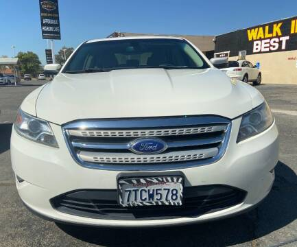 2011 Ford Taurus for sale at Global Auto Group in Fontana CA