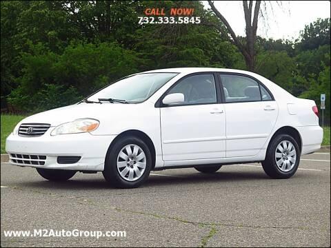 2004 Toyota Corolla for sale at M2 Auto Group Llc. EAST BRUNSWICK in East Brunswick NJ