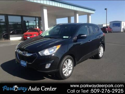 2011 Hyundai Tucson for sale at PARKWAY AUTO CENTER AND RV in Deer Park WA