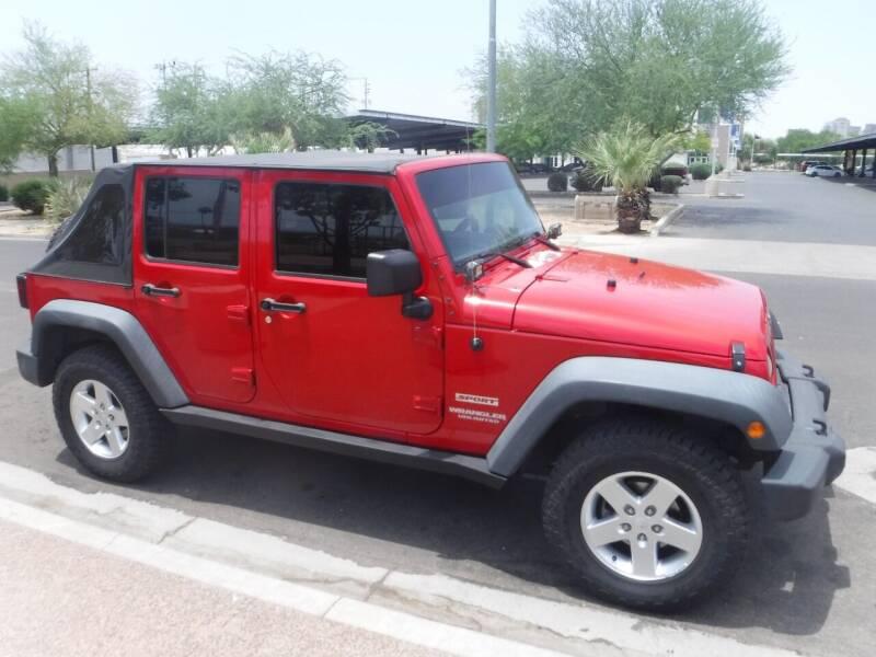 2010 Jeep Wrangler Unlimited for sale at J & E Auto Sales in Phoenix AZ