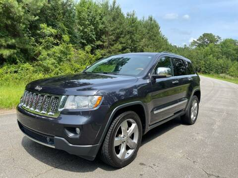 2013 Jeep Grand Cherokee for sale at Carrera AutoHaus Inc in Clayton NC